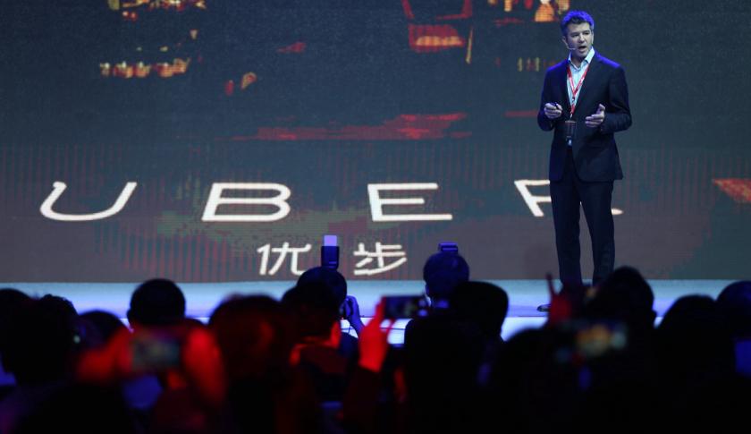 ทราวิส คาลานิก ซีอีโอ Uber แถลงข่าวในปักกิ่ง ภาพจาก Getty Images
